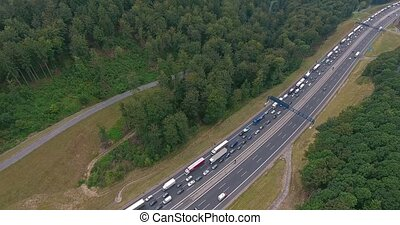 Aerial view of highway, traffic jam, green forest,...