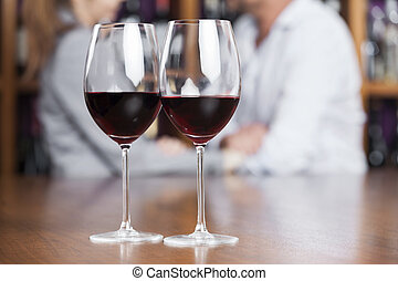 Red Wine In Glasses On Counter - Closeup of red wine in...