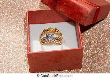 Golden Ring and Gift Box - Diamond ring of gold in a red...