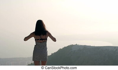 Young Slim Woman Stretching Arms While Standing On Terrace...