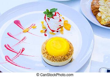 raspberry lemon tart on table