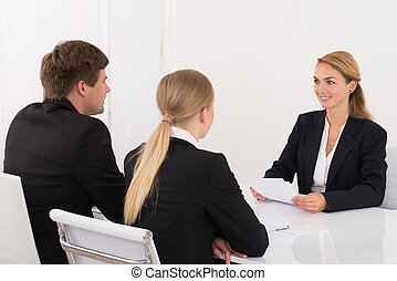 Manager Interviewing Applicant In Office