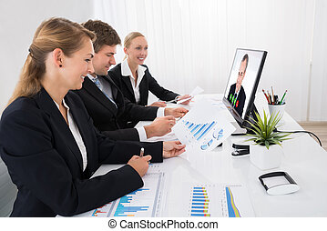 Businesspeople Video Conferencing On Computer