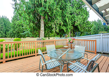 View of walkout deck with Patio furniture