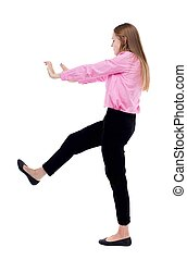 back view of business woman pushes wall. Isolated over white...