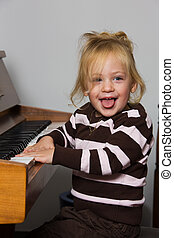 Child with piano - Child plays on a piano