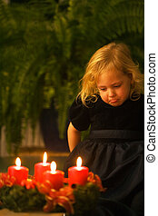 Child with Advent wreath for Christmas
