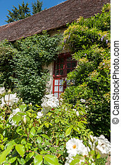 Typically picturesque 16th century French farmhouse in romantic setting
