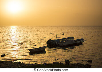 Silhouettes Mexican fishing boats at sunset - Traditional...