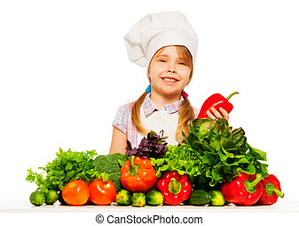 Smiling little girl preparing healthy food - Smiling 6 years...