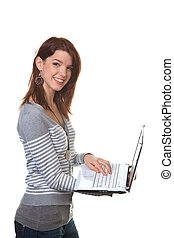 Successful young woman laughing with laptop computer