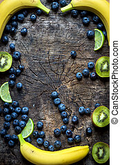 Studio photo of different fruits and vegetables on wooden...
