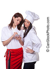 Cook and waitress talk - Service and cook together to...