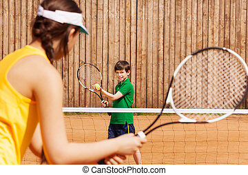 Boy holding tennis ball and racket, starting set - Sporty...
