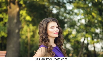 young beautiful woman walks in the park