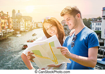 Smiling Couple With Map In Venice