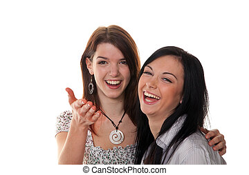 Two young women burst into laughter