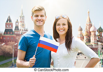 Young Couple Holding Russia Flag
