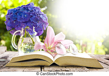 book on the old table with flowers
