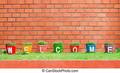 Colorful of the Welcome on brick background