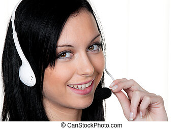 Woman with a headset in the customer service. Telephone...