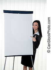 Coach before empty flipchart on education and training
