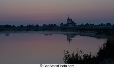 sunrise on the river near the church Ukraine