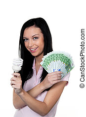 Woman with energy-saving lamp. Energy lamp and money ?