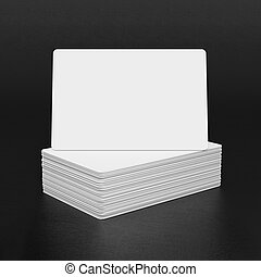 Business cards on black textured background.
