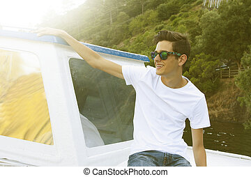 young man on yacht