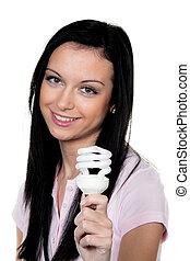 Woman with energy-saving lamp Energy saving lamp for