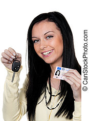 Woman with car keys and driver\'s license. Test