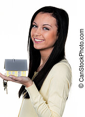 Woman with property and key to buying property