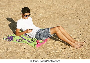 man with mobile on the beach