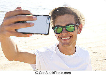 man on the beach with mobile