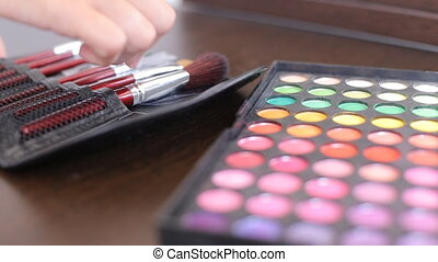Makeup eye shadow palette in many different colors, brush...