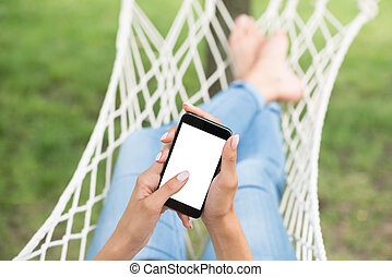 Female's Hand Holding Mobile Phone With Blank Screen -...