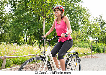 Young Woman Enjoying Ride On Bicycle - Smiling Young Happy...