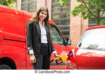 Businesswoman Refueling Cars Tank - Photo Of Smiling Young...