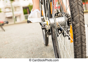 Close-up Of A Womans Leg Peddling Bicycle - Close-up Of A...