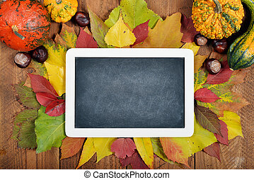 Thanksgiving Day Concept - Chalkboard over wooden background...