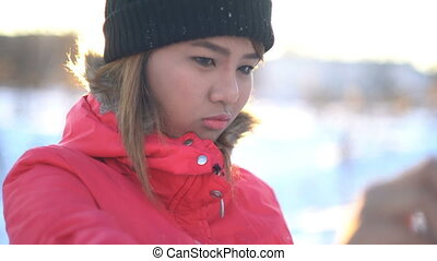 Young Woman making selfie in winter - Young Asian Woman...