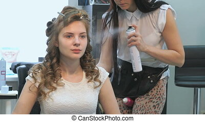 Professional barber makes hairstyle for the model