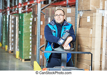 Worker man with warehouse barcode scanner