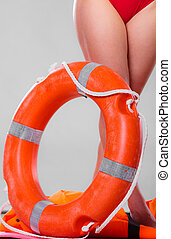 Life buoy ring and female legs - Accident prevention and...