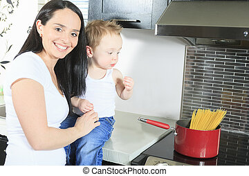 family cook pasta inside the kitchen
