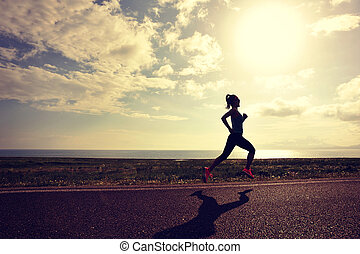 healthy lifestyle young woman runner running on beautiful...
