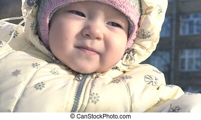 Portrait of baby girl in winter.