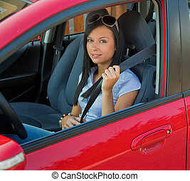 Woman with a seat belt in a car - Young woman strapped to...