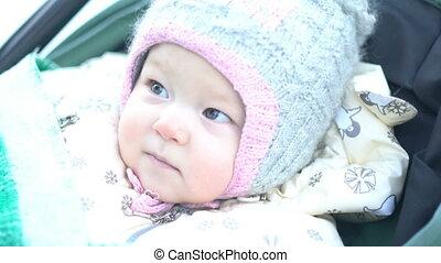 Portrait of suspecting baby girl
